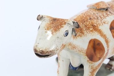 Lot 5-Prattware cow creamer and cover, c.1800