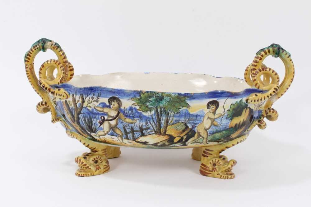 Lot 18-Good Cantagalli maiolica centrepiece, painted with classical scenes, with serpent-form handles, cockerel mark to base, 41cm across