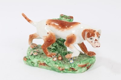 Lot 95 - Late 18th century Derby porcelain model of a Pointer, shown mid-stride on a grassy base, 16cm length from head to tail