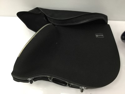 Lot 7-Holton French horn case, black fabric finish and soft cover, together with another French horn case