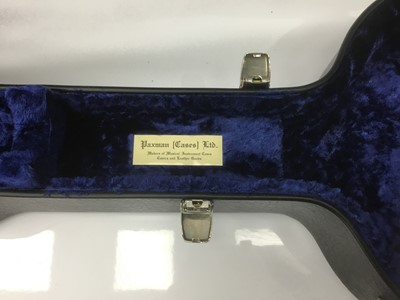Lot 9-Hard guitar case by Paxman, black finish, together with another Paxman guitar case with blue velvet lining, one other hard guitar case