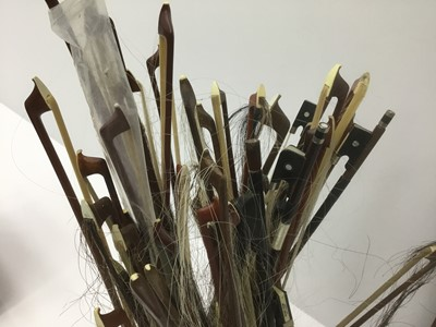 Lot 20-Large collection of violin, viola and cello bows for refurbishment