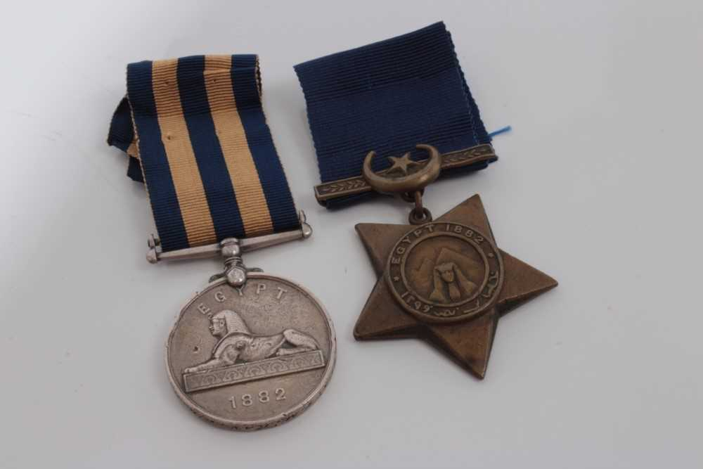 Lot 203-Victorian Egypt medal pair, comprising Egypt medal (1882 - 89), with dated reverse, named to 3704. GUN. T. Mc. Kay. G/B. R.H.A. together with a Khedive's Star (1882) (2)