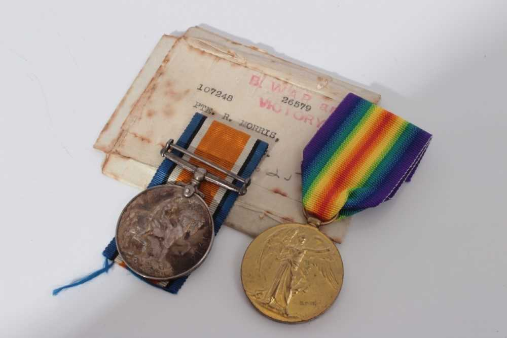 Lot 217-First World War pair comprising War and Victory medals named to 107248 Pte. R. Morris. M.G.C. together with original box of issue