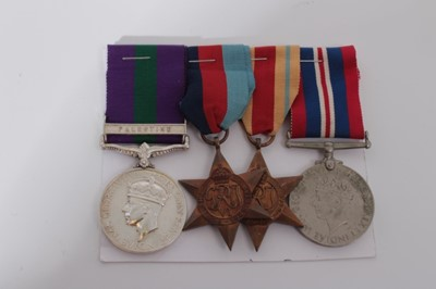 Lot 231-Second World War and later medal group comprising 1939 - 1945 Star, Africa Star and War medal together with a George VI General Service medal with one clasp- Palestine, named to 4973903 Pte. J.T. T...