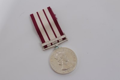 Lot 235-Elizabeth II Naval General Service medal with one clasp- Near East, named to P/JX.911545 R.W. Rowlands. A.B. R.N.