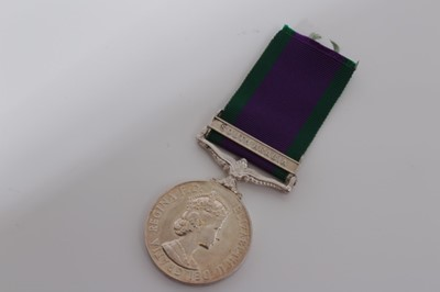Lot 241-Elizabeth II Post 1962 type General Service medal with one clasp- South Arabia, named to RM23031 K Cole. MNE. R.M.