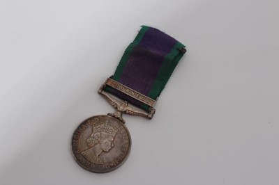 Lot 239-Elizabeth II Post 1962 type General Service medal with one clasp- Borneo, named to RM23818 T.P. Dunne. R.M. (Replacement)