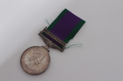 Lot 240-Elizabeth II Post 1962 type General Service medal with one clasp- Borneo, named to R M. 15505 J.F. Dunbar. MNE. R.M.