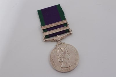 Lot 244-Elizabeth II Post 1962 type General Service medal with two clasps- Radfan and South Arabia named to R 0586948 CH. Tech. D.J. Upstone. R.A.F.