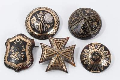 Lot 5-Group of five 19th century tortoishell piqué work brooches various, with floral decoration to include a Maltese cross brooch, 32-40mm diameter