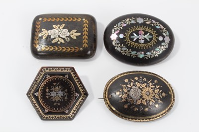 Lot 7-Group of four 19th century tortoishell piqué work brooches various, with floral decoration. 35mm-45mm