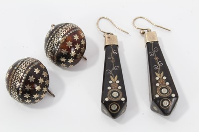 Lot 10-Two pairs of 19th century piqué work earrings, one pair of circular domed form with star decoration, 20mm diameter and the other pair with floral decoration 50mm