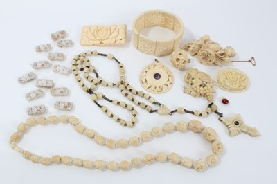 Lot 14-Group of antique ivory, bone and similar  jewellery to include a 1920s carved ivory pendant with central amethyst cabochon, finely carved 19th century Dieppe ivory brooch depicting roses, and other...