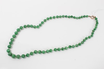 Lot 15-Old Chinese jade/green hardstone bead necklace with a string of graduated spherical beads measuring approximately 6 to 9mm diameter, approximately 54cm length
