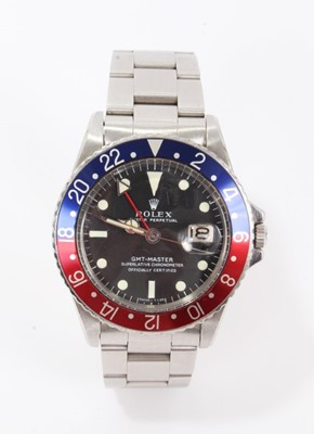 Lot 1-Rare 1960s gentlemen's Rolex Oyster Perpetual GMT-Master stainless steel wristwatch, model 1675, serial number 1798453, circa 1965-1966, the matte black dial with luminous hour markers and date ape...