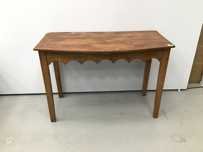 Lot 57 - Old pine bow front side table with gothic arched frieze on square taper legs