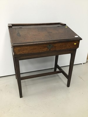 Lot 56 - Georgian oak clarks' desk with fitted interior on square taper legs