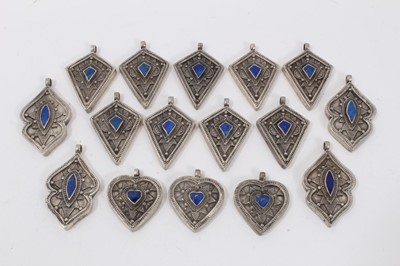 Lot 3 - Collection of 16 Eastern white metal pendants each set with lapis lazuli. Sizes from 3cm to 4.3cm