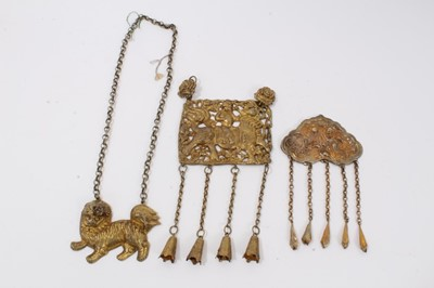 Lot 4 - Old Chinese gilt metal panel necklace decorated with a figure riding a dragon, one other gilt metal figurative panel and a gilt metal dog of foo necklace