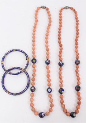 Lot 10 - Two Chinese pink hard stone and cloisonné bead necklaces, plus two cloisonné bangles