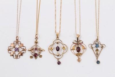 Lot 11 - Five Edwardian 9ct gold gem set open work pendants on 9ct gold chains