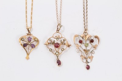 Lot 12 - Three Edwardian 9ct gold seed pearl and gem set open work pendants on 9ct gold chains
