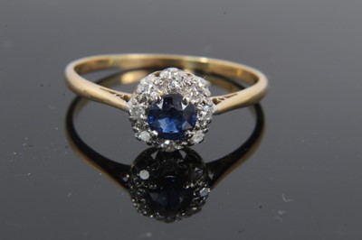 Lot 22 - Sapphire and diamond cluster ring