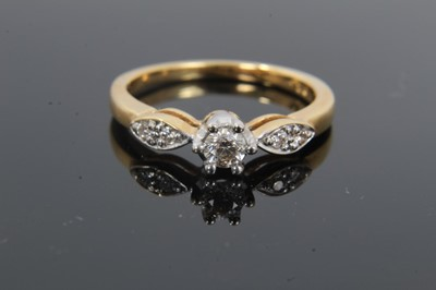 Lot 24 - 18ct gold diamond single stone ring with diamond set shoulders