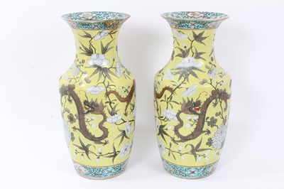 Lot 6 - Pair 19th century Chinese Dayazhai-style porcelain baluster vases, decorated with dragons amongst flowers, on a yellow ground, 35cm height