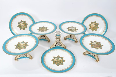 Lot 11 - 19th century English porcelain part dessert service, possibly Minton, decorated in the aesthetic style with central panels containing painted pastoral scenes, including five tazza and eleven plates...