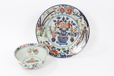 Lot 22 - Early Japanese Edo period Imari dish, c.1700, painted with vases of flowers, further floral patterns, and two phoenixes around the edge, repaired, 32cm diameter