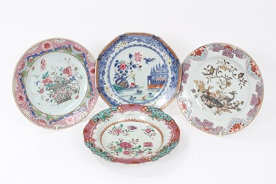 Lot 23 - Four 18th century Chinese famille rose porcelain dishes, including two painted with flowers, another painted en grisaille with two deer, and another with a watery landscape