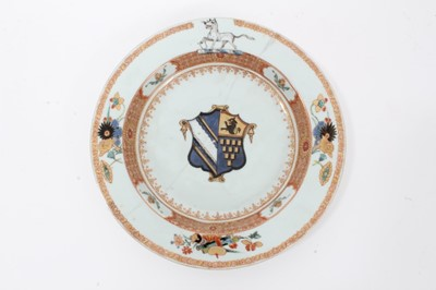 Lot 25 - Good quality 18th century Chinese famille rose armorial porcelain dish, the centre painted with coat of arms, surmounted by a hound on the border, with floral patterns and precious objects, 22.75cm...
