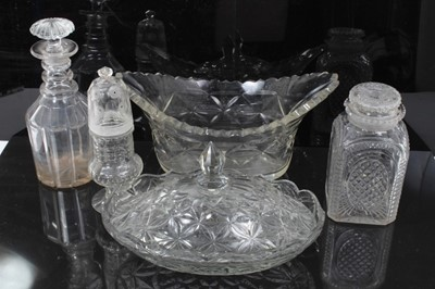 Lot 35 - Group of early 19th century cut glass, including a three-ring decanter with mushroom stopper, a square lidded jar, an unusual sugar caster with threaded top, an oval dish, and a further covered dis...