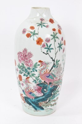 Lot 43 - Antique Chinese Qing period semi-eggshell porcelain vase with a textured surface, decorated in a famille rose palette with two hoho birds in a stream, surrounded by flowers and foliage, 26cm height