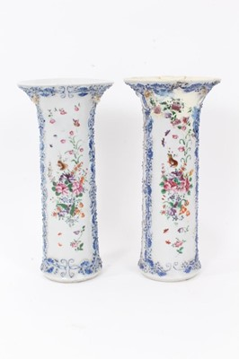 Lot 44 - Pair antique Chinese Qianlong period famille rose sleeve vases, painted with flowers, birds and insects, with relief moulded vine and squirrel decoration, 25.5cm height