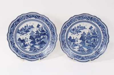 Lot 50 - Fine quality pair of antique 18th century Chinese blue and white porcelain plates, of scalloped form with moulded rims, painted with landscape scenes, 24cm diameter