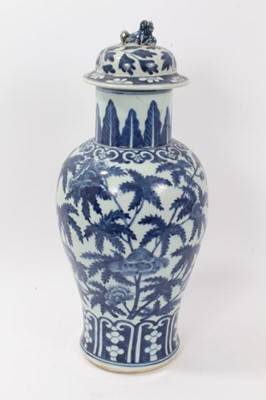 Lot 52 - Large antique late 19th century Chinese blue and white porcelain vase and cover, of baluster form, decorated with foliate patterns, the cover with foo dog knop, total height 48cm