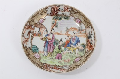 Lot 54 - Antique 18th century Chinese famille rose export porcelain saucer, painted in the Mandarin style with a figural scene, including a seated man having his feet washed, 15cm diameter