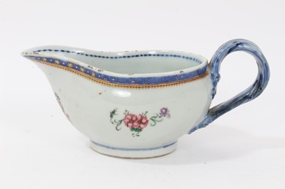 Lot 58 - Antique Chinese famille rose Armorial porcelain sauce boat, c.1800, the armorial at the front with motto reading 'Sit Ordo In Omnibus', the sides with floral sprays, patterned borders and double st...
