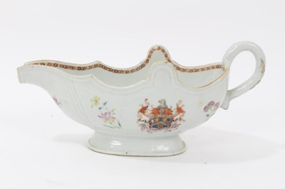 Lot 59 - Antique 18th century Chinese famille rose Armorial porcelain sauce boat, the armorial painted on both sides, the motto faded but appears to read 'Mea Fides Gloria', adorned with floral sprays, 24cm...