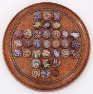 Lot 464 - Victorian glass marbles on a solitaire board