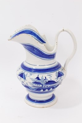 Lot 65 - 19th Century tin glazed pottery jug with blue and white chinoiserie decoration
