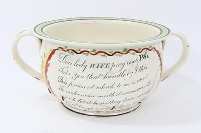 Lot 66 - Amusing early 19th century creamware chamber pot