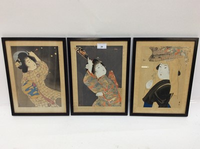 Lot 30 - Three antique Japanese coloured woodcuts depicting female figures, signed, in glazed gilt frames, 32.5cm x 23.5cm