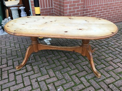 Lot 87 - Pine kitchen table on twin pedestal base joined by stretcher
