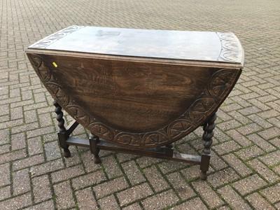 Lot 74 - Carved oak oval drop leaf table