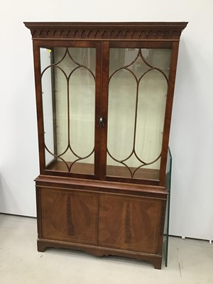 Lot 2 - Good quality George III-style mahogany two height display cabinet, the top enclosed by gothic astragal glazed doors with cupboards below