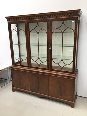 Lot 3 - Good quality George III-style mahogany two height display cabinet, the top enclosed by gothic astragal glazed doors with cupboards below